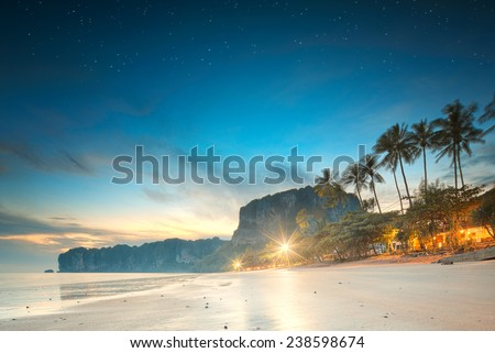 beautiful beach with colorful sky at sunrise or sunset, Thailand - stock photo