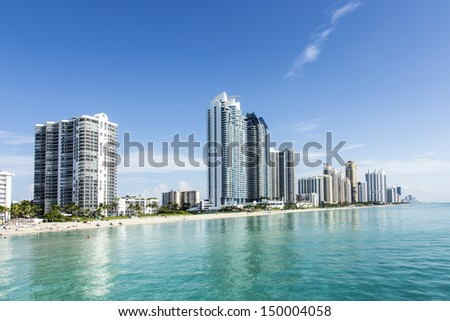 beautiful beach with condominiums and skyscraper in Sunny Islands, Miami - stock photo
