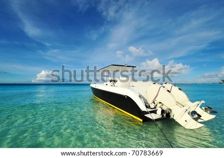 Beautiful beach with motor boat at Boracay island, Philippines - stock photo