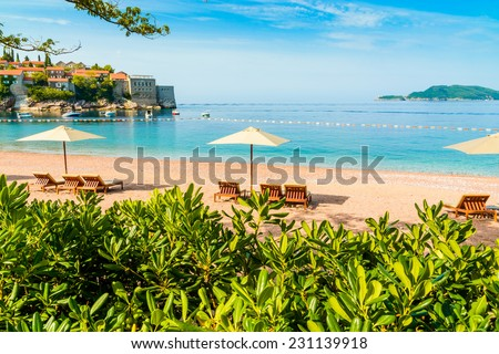 Beautiful beach with sunshades in Montenegro, Balkans, Adriatic Sea. - stock photo