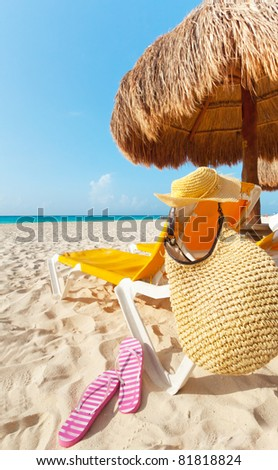 Beautiful beach with vacations accessories - stock photo