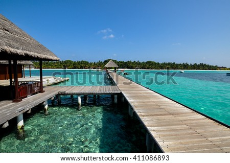 Beautiful beach with water bungalows at Maldives.