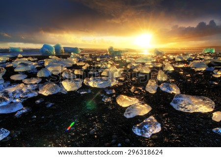 Beautiful beached chunks of ice at the beach at Jokulsarlon, Iceland, at sunset in winter. HDR - stock photo