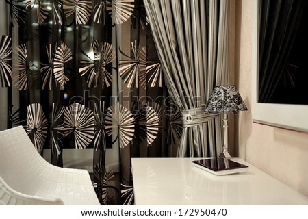 Beautiful bedroom decor with a table and lamp . - stock photo