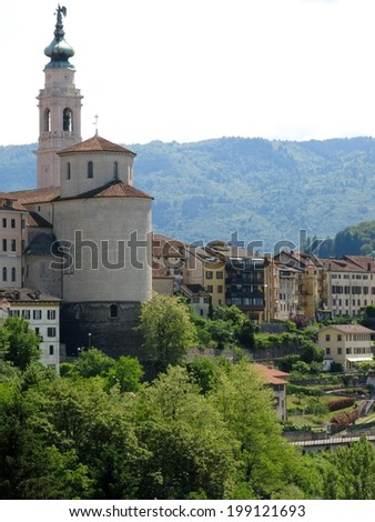 Beautiful Belluno church town houses village Italy.