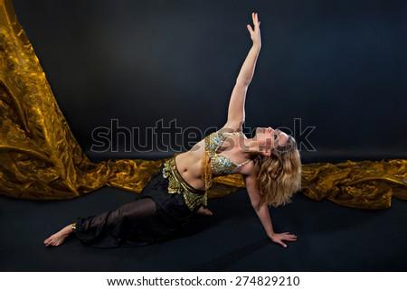 Beautiful belly blonde dancer in costume dancing - stock photo