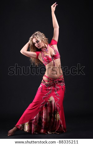 beautiful belly dancer woman posing on black background