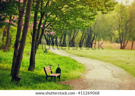 beautiful bench in the park. spring sunny day - stock photo