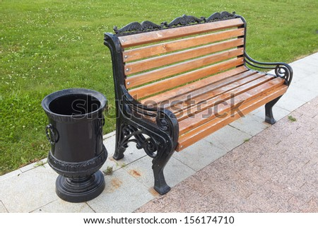 Beautiful bench with cast iron in the park - stock photo