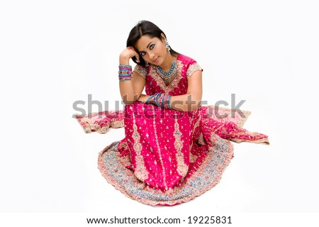 Beautiful Bengali bride in colorful dress day dreaming, isolated
