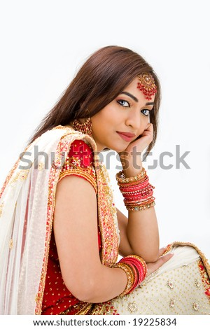 Beautiful Bengali bride in colorful dress day dreaming, isolated - stock photo