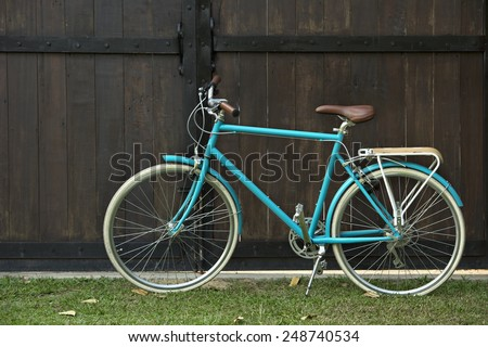 beautiful bicycle on brown background - stock photo