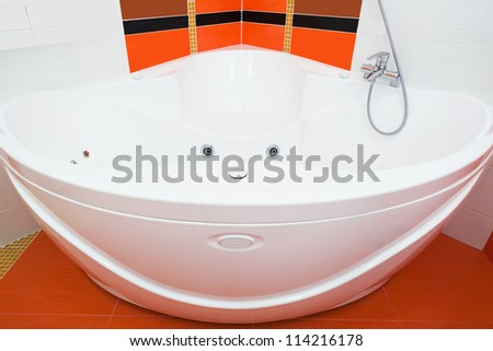 beautiful big bath in the new bathroom - stock photo