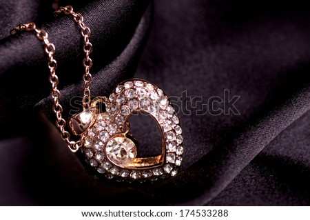 Beautiful bijouterie on black background  - stock photo