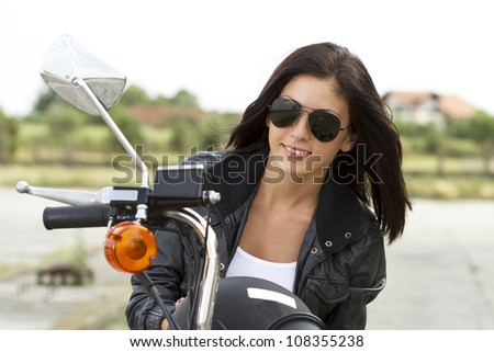 Beautiful biker girl portrait - stock photo