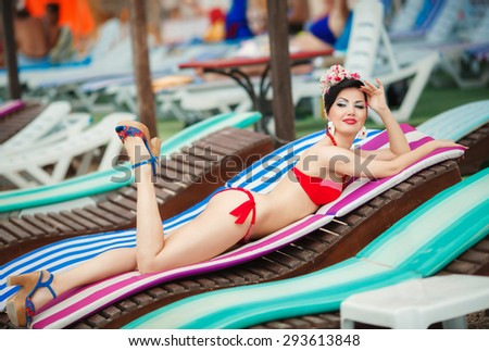Beautiful bikini woman at beach girl pinup outdoors portrait happy girl retro style at vacation at beach, smiling female summer portrait, elegant lady pin up, retro tonality and instagram style filter - stock photo