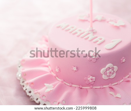 Beautiful birthday cake for baby girl. Selective focus - stock photo