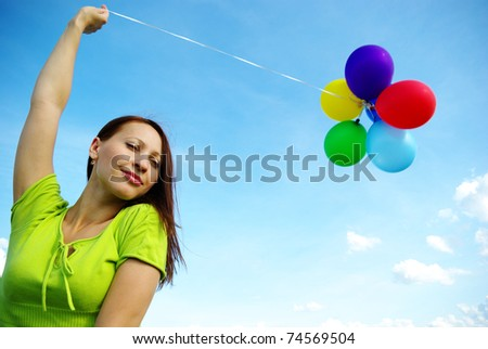 Beautiful birthday girl  with colorful baloons - stock photo