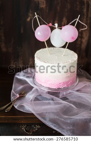beautiful birthday / wedding cake with cream cheese frosting. Decorated with tiny balloons. Selective focus. - stock photo