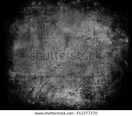 Beautiful black abstract vintage grunge background with faded central area for your text or picture, scratched scary background with frame