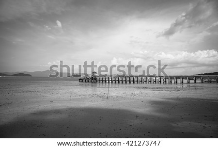 Beautiful Black and white jetty with seascape.
