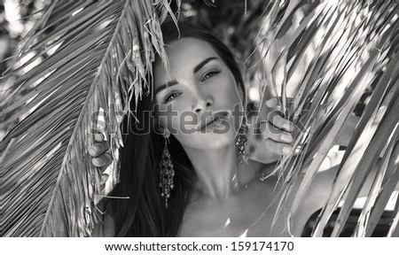 Beautiful black and white photo of young female model - stock photo