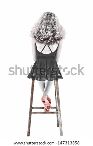 Beautiful black and white portrait of sitting ballerina with pink slippers.  Over white with clipping path. - stock photo