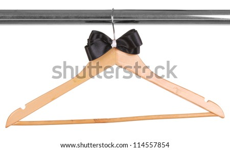 Beautiful black bow hanging on wooden hanger isolated on white - stock photo