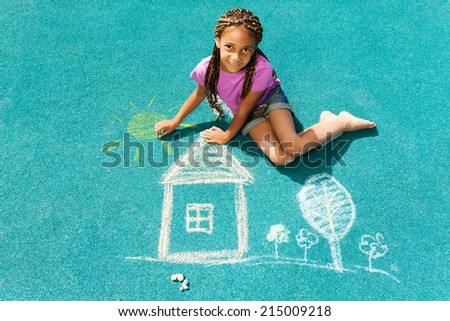 Beautiful black girl draw with chalk - stock photo