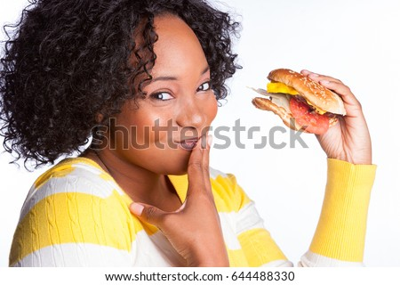 Beautiful black girl eating burger