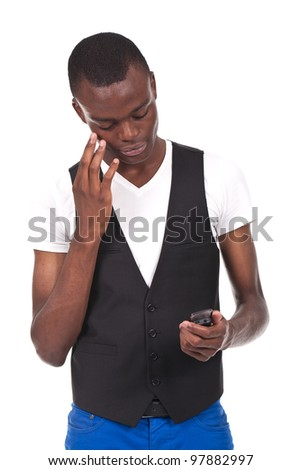 beautiful black man holding a phone and looking worried