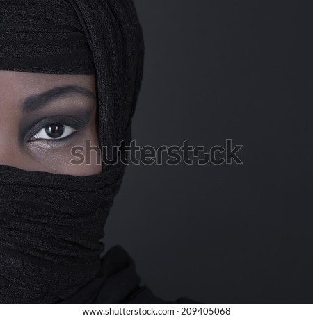 Beautiful black oriental colored woman: eyes and beauty. - stock photo