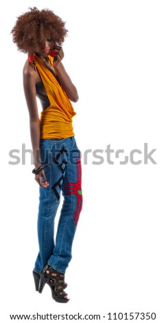 Beautiful black teen in bluejeans and yellow top. - stock photo