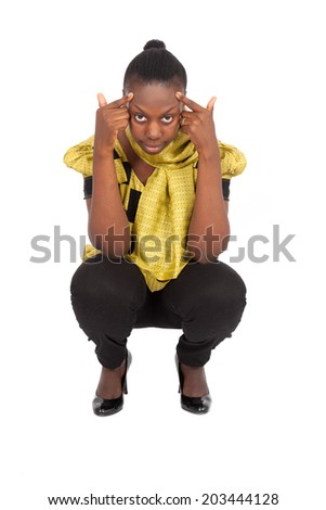 Beautiful black woman doing different expressions in different sets of clothes: posing - stock photo