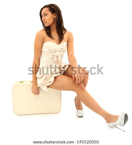 Beautiful Black Woman in Coctail Dress and Suitcase  - stock photo