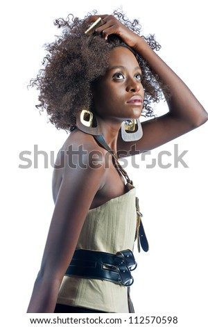 Beautiful black woman isolated on a white background pulls her hair out of her eyes.