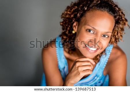 Beautiful black woman looking very happy and smiling
