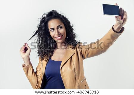 Beautiful black woman making self-portrait with phone  - stock photo