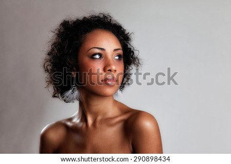 Beautiful black woman posing in a studio. Perfect makeup. Beauty fashion .Close-up portrait of attractive young model with bright make-up. - stock photo