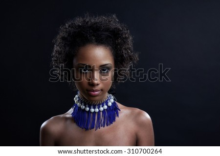 Beautiful black woman posing in a studio. Perfect makeup. Beauty fashion .Close-up portrait of attractive young model with bright make-up.