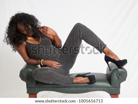 Beautiful Black woman sitting thoughtfully on a bench