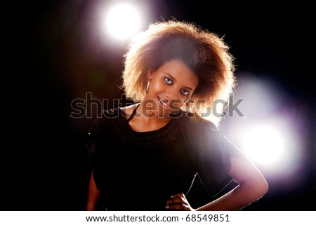 beautiful black  woman, smiling, isolated on black background - stock photo