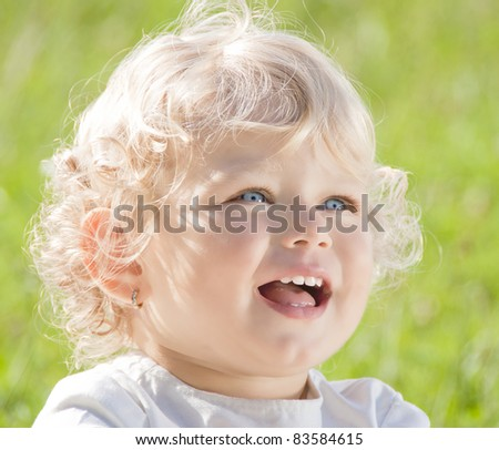 Beautiful blond baby girl smiling - stock photo