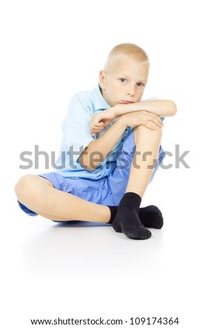 beautiful blond boy sitting - stock photo