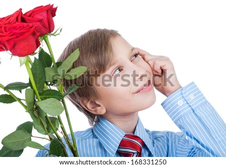 Beautiful blond boy wearing a shirt and a tie holding a bouquet of red roses smiling and thinking  (romantic gift concept) - stock photo