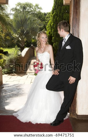 Beautiful Blond bride and her groom on their wedding day