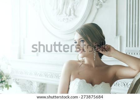 Beautiful Blond Bride Happy Smiling In Rays Of Light. Celebration Wedding Expression Photoshoot - stock photo
