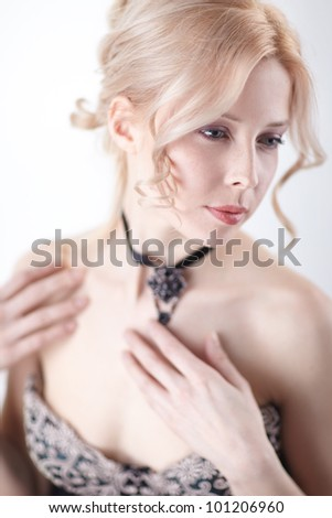 beautiful blond-brown woman portrait and shoulder over white