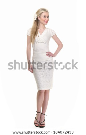 beautiful blond business woman model in summer white suit isolated on white