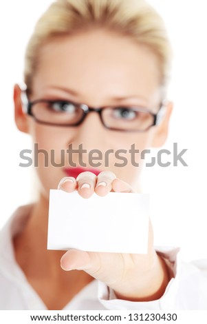 Beautiful blond businesswoman with businesscard - stock photo